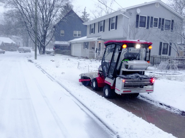 The SnowBuddy tractor, driven and funded by volunteers, clears all 12 miles of sidewalk of the Water Hill neighborhood of Ann Arbor, Michigan. (Paul Tinkerhess)